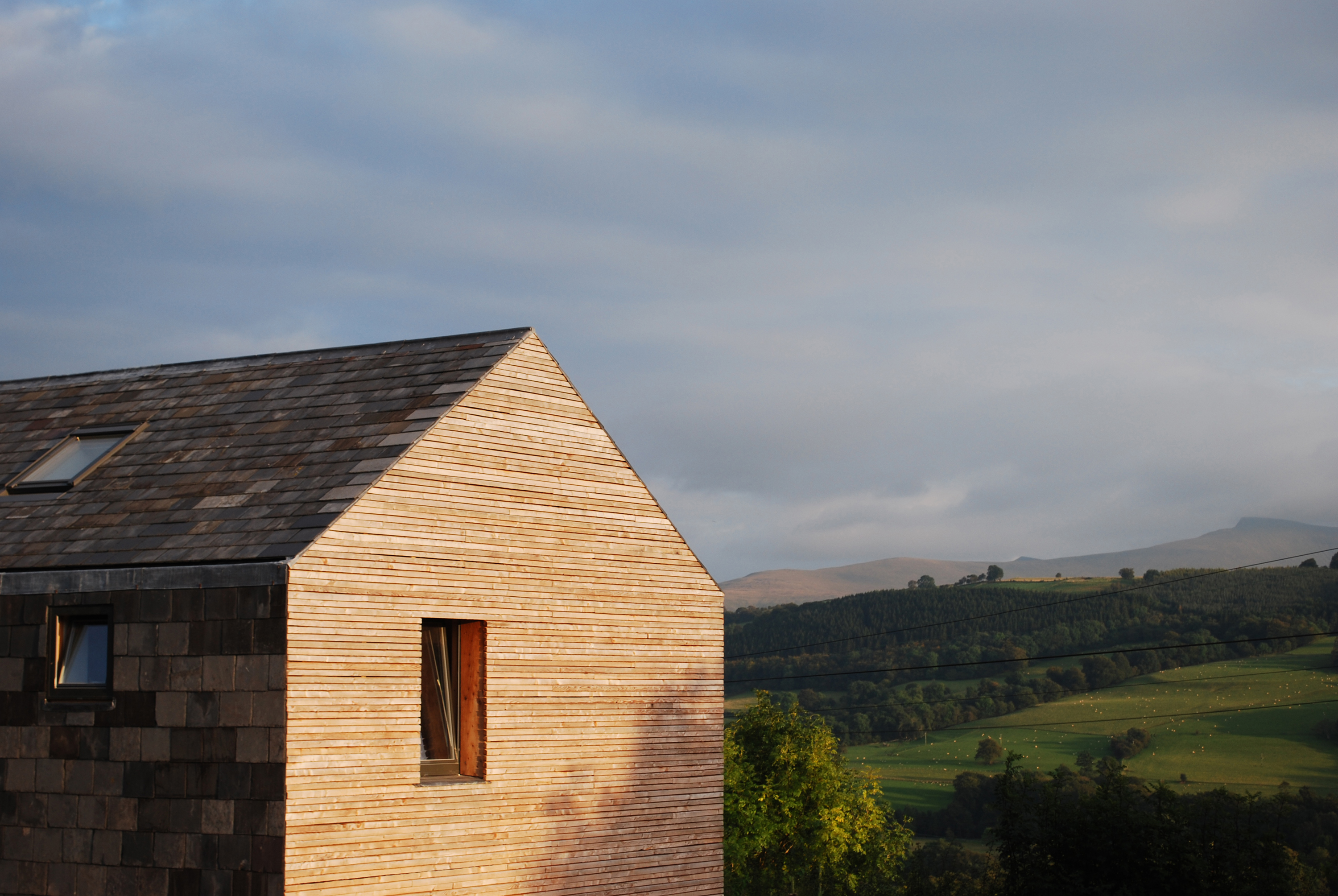 West elevation & landscpae beyond (c) Feilden Fowles