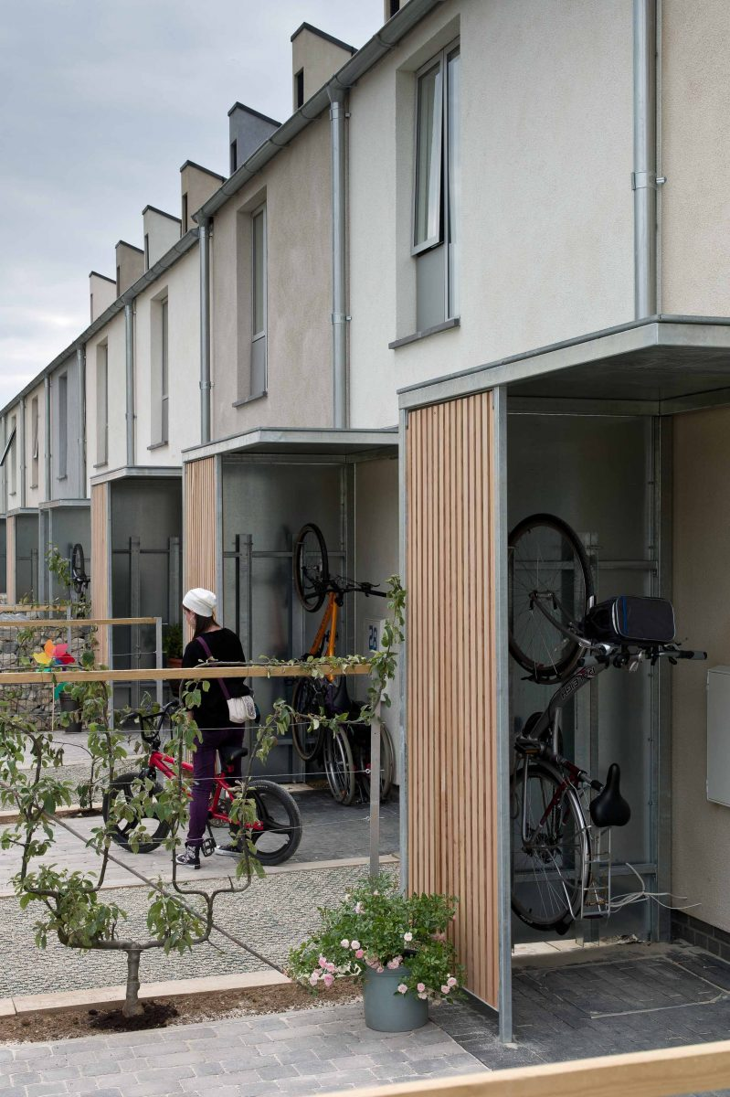 4 The Triangle_Front doors and bicycles_(c) Glen Howells Architects_edited